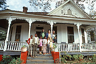 December 1976. Americus, Georgia. Families posing in front of their homes in Americus.