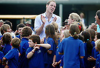 KERANG, AUSTRALIA - MARCH 21:  HRH Prince William visits with local students from Marrabit at the Marrabit Recreational Grounds on March 21, 2011 in Marrabit, Australia. His Royal Highness is in Victoria to visit towns affected by recent flooding in the State. This is his final day of a three-day tour of Australia to visit regions devastated by floods and Hurricane Yasi. His trip to Australia followed a two day visit to New Zealand where he attended a national Christchurch Earthquake memorial service and visited families who lost loved ones at the Pike River Mine in Greymouth.  (Photo by Marianna Massey/WireImage)
