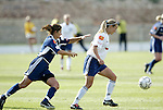 19 June 2004: Mia Hamm (left) and Heather Mitts (right). The Washington Freedom tied the Boston Breakers 3-3 at the National Sports Center in Blaine, MN in Womens United Soccer Association soccer game featuring guest players from other teams.