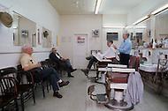 December 1976. Americus, Georgia. White barber shop in Americus.