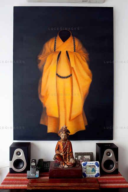 Painting by Tuan Thai Nguyen hang's in Dinh Q. Le's home. One of many pieces in Le's collection of other artists...Dinh Q. Le is a Vietnamese American fine arts photographer best known for his woven-photographs. Le uses traditional weaving techniques to combine mournful images from the Vietnam War with a sort of colorful fantasy. Le now works from his home in Ho Chi Minh City, Vietnam.