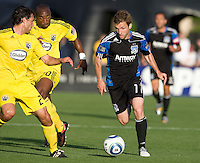 Bobby Convey of the Earthquakes controls the ball away from Crew defenders during the game at Buck Shaw Stadium in Santa Clara, California.  San Jose Earthquakes tied Columbus Crew, 2-2.