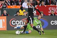 D.C. United defender Robbie Russell (3) goes against Seattle Sounders midfielder Brad Evans (3) D.C. United tied the Seattle Sounders, 0-0 at RFK Stadium, Saturday April 7, 2012.