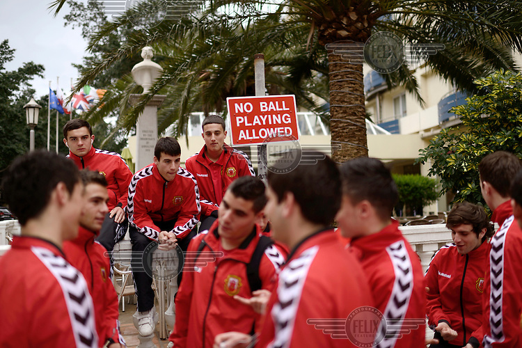 A sign reads: 'No Ball Playing Allowed' in a square where players from the Gibraltarian under-17 national team are relaxing prior to a match against Northern Ireland in March 2013. Although the United Nations doesn't recognise Gibraltar as an independent country, UEFA has recognised it and has granted the British Overseas Territory full UEFA membership.
