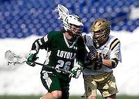 Marty Gallagher (26) of Navy tries to stop Stephen Murray (26) of Loyola at the Navy-Marine Corp Memorial Stadium in Annapolis, Maryland.   Loyola defeated Navy, 8-7, in overtime.
