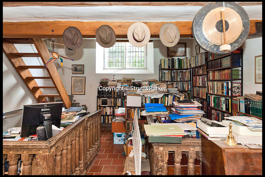 BNPS.co.uk (01202 558833)<br /> Pic: Strutt&amp;Parker/BNPS<br /> <br /> *Please use full byline*<br /> <br /> An interior shot of the building.<br /> <br /> The owner of this converted church will be praying that a still in use graveyard won't put people off snapping up his unusual home.<br /> <br /> Old All Saints Church dates from the early 16th century with additions and renovations added later, but the churchyard around it is open to the public and still has one or two burials a year.<br /> <br /> The quirky home, which is Grade II* listed and almost 1,300 sq ft, consists of a kitchen and bathroom in the chapel, the nave and chancel have been converted to create a living, dining and study areas and a mezzanine floor was put in to create a bedroom.<br /> <br /> The current owner bought it as a derelict church in the 1970s and got planning permission to turn it into a home. He has lived there since but, following the death of his partner, decided to downsize and sell this unusual property.<br /> <br /> Sharnie Rogers from Strutt &amp; Parker, who are selling the property, said it still has all the characteristics of a church and there is still potential for more conversion to be done.