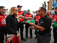 Feb 26, 2017; Chandler, AZ, USA; NHRA top fuel driver Leah Pritchett and crew during the Arizona Nationals at Wild Horse Pass Motorsports Park. Mandatory Credit: Mark J. Rebilas-USA TODAY Sports