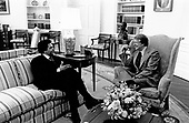 United States President Jimmy Carter, right, meets with Maynard Jackson (Democrat of Atlanta, Georgia) in the Oval Office of the White House in Washington, DC on February 1, 1977.<br /> Credit: White House via CNP