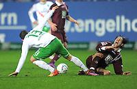 FUSSBALL   1. BUNDESLIGA  SAISON 2011/2012   18. Spieltag 1. FC Kaiserslautern - SV Werder Bremen        21.01.2012 Lukas Schmitz (li, SV Werder Bremen) gegen Olcay Sahan (1. FC Kaiserslautern)