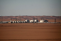 November 23, 2014 - Ubari region, Libya: Al-Sharara oilfield installations are seen powered off in Southwest of Libya. Fighting around Southwest Ubari region ignited after Tuareg militias from Mali and Libya sized control over the vast oilfield installations aligned with the Third Force of Misrata armed forces. Since then raged battles have taken place between two factions: one faction of Tuareg fighters lead by Third Force from Misrata pushing to clean the region from the other faction of Tebu tribal fighters defending their controlled territory. (Photo/Narciso Contreras)