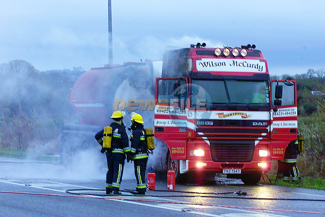 the charded remains of the lorrythat  went on fire late on Monday evening causing Traffic cahos on the M1 motorway. .Photo Fran Caffrey Newsfile.ie  Story Elaine Keogh..This Picture has been sent to you by Newsfile Ltd..The Studio,.Millmount Abbey,.Drogheda,.Co. Meath,.Ireland..Tel: +353(0)41-9871240.Fax: +353(0)41-9871260.ISDN: +353(0)41-9871010.www.newsfile.ie..general email: pictures@newsfile.ie