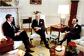 United States President Ronald Reagan meets with (left) former Prime Minister Saeb Salam and Foreign Minister Salem of Lebanon in the Oval Office on Wednesday, March 16, 1983..Mandatory Credit: Michael Evans - White House via CNP
