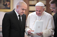 Pope Francis meets Bosnian Prime Minister Vjekoslav Bevanda during a private audience at the Vatican, on November 22, 2013.