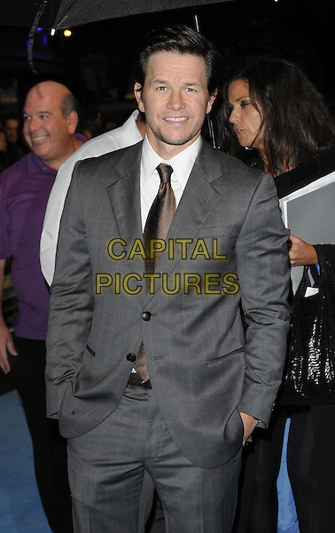 MARK WAHLBERG .UK Film Premiere of 'The Other Guys' at Vue West End cinema, Leicester Square, London, England, UK,.September 14th 2010..half length hands in pockets suit grey gray white shirt tie brown  checked .CAP/CAN.©Can Nguyen/Capital Pictures.