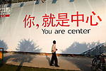 "Advertising hoarding for a real estate development in China's richest city with slogan suggestive of new individualism: ""You are Center""..From China [sur]real © Mark Henley.."