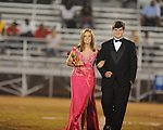 Meghan Sharp (left) is escorted by Will Andrews during Lafayette High vs. Byhalia in homecoming football action in Oxford, Miss. on Friday, September 24, 2010.