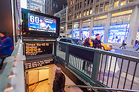 An electronic billboard on a subway entrance in Times Square in New York, owned by CBS Outdoor America, shows advertising on Tuesday, March 18, 2014. CBS announced that it will spin off its outdoor advertising unit, CBS Outdoor America in an initial public offering valuing the company at $3.3 billion. CBS Outdoor has approximately 330,000 billboards in the United States with 47% in New York. After the IPO CBS will still own 83% of the company. (© Richard B. Levine)