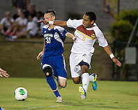 Winthrop University Eagles vs the Brevard College Tornados at Eagle's Field in Rock Hill, SC.  The Eagles beat the Tornados 6-0.  Rhem Stubbs (31) and C.J. Miller (5) vie for the ball.