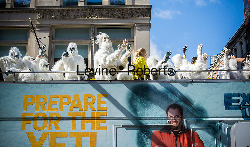 "Actors dressed in ""Yeti"" costumes dance on the upper deck of a tour bus as it drives through the streets of New York on Tuesday, October 4, 2016 as a promotional branding event for the Travel Channel's ""Hunt for the Yeti"" program. (© Richard B. Levine)"