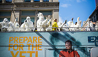 """Actors dressed in """"Yeti"""" costumes dance on the upper deck of a tour bus as it drives through the streets of New York on Tuesday, October 4, 2016 as a promotional branding event for the Travel Channel's """"Hunt for the Yeti"""" program. (© Richard B. Levine)"""