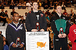 12 MAR 2011:  Ryan Pankoke of Nebraska-Omaha (in black with red trim) on the podium with his award after defeating Luke Rynish of Wisconsin-Parkside during the Division II Men's Wrestling Championship held at the UNK Health and Sports Center on the University of Nebraska - Kearney campus in Kearney, NE.  Pankoke defeated Rynish to win the 174-lb national title.  Scott Anderson/NCAA Photos