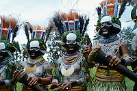 Culture in Papua New Guinea - women singing and making music at a sing sing meeting of tribes.