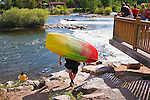 A colorful kayak being carried down to Brennan's Wave in Missoula, Montana