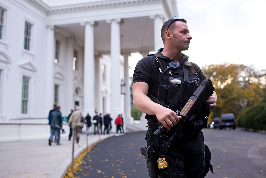 A Secret Service agent with the Counter Assault and Tactical Division stands guard in front of the North Portico of the White House in Washington...