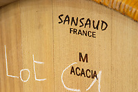 Acacia wood barrel from Sansaud, medim toast. Oak barrel aging and fermentation cellar. Chateau Malartic Lagraviere, Pessac Leognan, Graves, Bordeaux, France