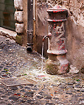 Water is always running from some street hydrants in Rome, Italy.  This one is near the Piazza Navona.