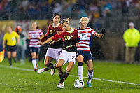 Lena Goessling (20) of Germany (GER) challenges Megan Rapinoe (15) of the United States (USA). The United States (USA) and Germany (GER) played to a 2-2 tie during an international friendly at Rentschler Field in East Hartford, CT, on October 23, 2012.