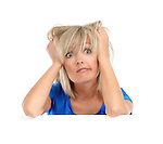 Emotional humorous portrait of a desperate woman pulling her hair. Isolated on white background.