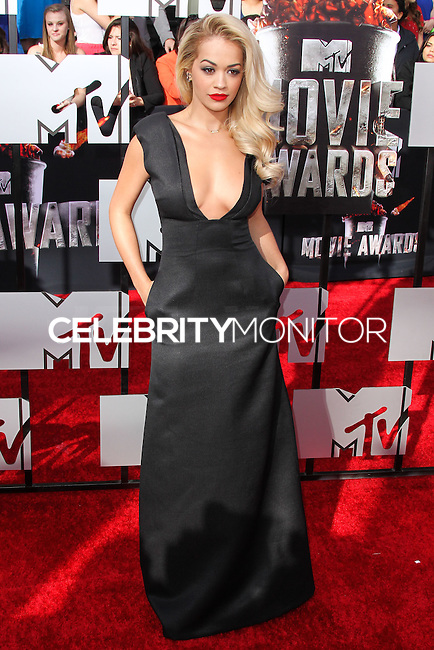 LOS ANGELES, CA, USA - APRIL 13: Singer Rita Ora arrives at the 2014 MTV Movie Awards held at Nokia Theatre L.A. Live on April 13, 2014 in Los Angeles, California, United States. (Photo by Xavier Collin/Celebrity Monitor)