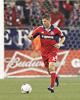 Chicago Fire midfielder Logan Pause (12) brings the ball forward. In a Major League Soccer (MLS) match, the New England Revolution defeated Chicago Fire, 2-0, at Gillette Stadium on June 2, 2012.