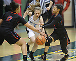 0469<br /> Chugiak&rsquo;s Carolina Houser struggles with a pair of East defenders in their quarterfinal state tournament action Thursday, March 23,  2017.  Photo for the Star by Michael Dinneen