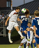 Winthrop University Eagles vs the Brevard College Tornados at Eagle's Field in Rock Hill, SC.  The Eagles beat the Tornados 6-0.  Mason Lavallet (9) and Augusto Isern (18) vie for the header off of a corner kick.