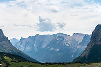 View of mountains and clouds looking east from Logan Pass