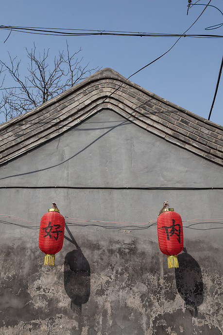 Chinese lantern hanging beside an old house at one of the surviving Beijing Hutong.