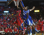 Ole Miss guard Chris Warren (12)  has his shot blocked by Kentucky's DeAndre Liggins (34) and Kentucky's Terrence Jones (3) at the C.M. &quot;Tad&quot; Smith Coliseum in Oxford, Miss. on Tuesday, February 1, 2011. Ole Miss won 71-69.