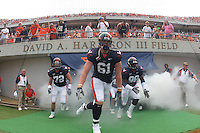 Virginia enters the field before the win over Georgia Tech in Charlottesville, VA. (Photo/Andrew Shurtleff)