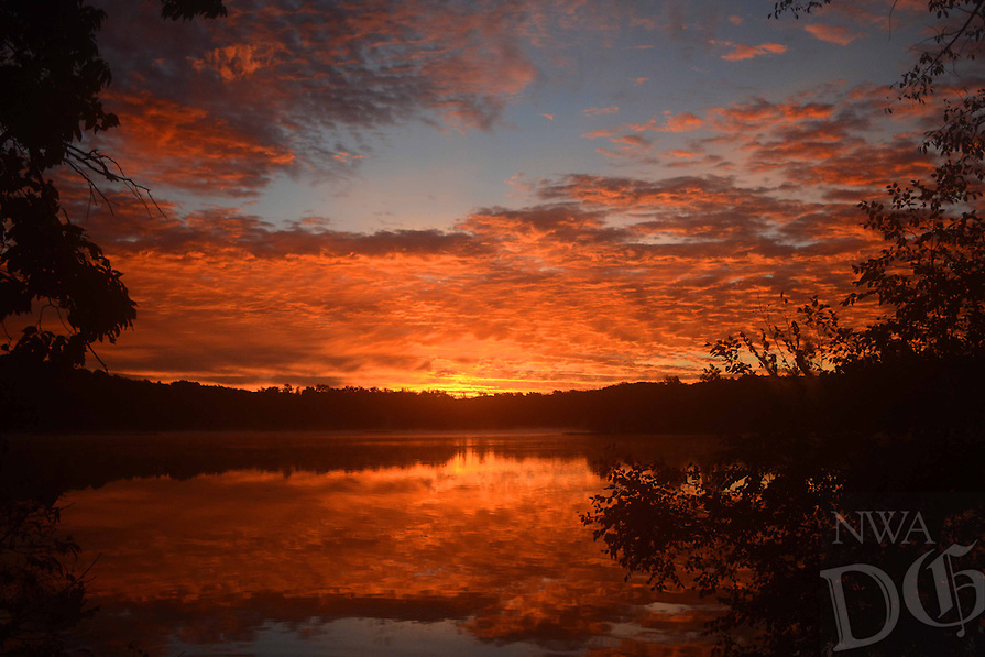 Courtesy photo/TERRY STANFILL<br /> COLORFUL DAWN<br /> A colorful sunrise is seen at Siloam Springs Lake. Terry Stanfill of the Decatur area took the picture in September.