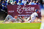7 March 2010: Washington Nationals' utilityman Willie Harris tags New York Mets first baseman Ike Davis caught off third during a Spring Training game at Tradition Field in Port St. Lucie, Florida. The Mets edged out the Nationals 6-5 in Grapefruit League pre-season play. Mandatory Credit: Ed Wolfstein Photo