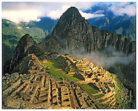 Morning fog and sun at Machu Picchu, Machu Picchu National Park, Peru  Anccient Inca stronghold in Andes Mountains