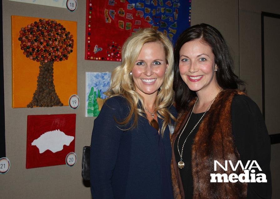NWA Democrat-Gazette/CARIN SCHOPPMEYER Courtney Barton (left) and Sara Davis attend the Fayetteville Montessori School art auction.