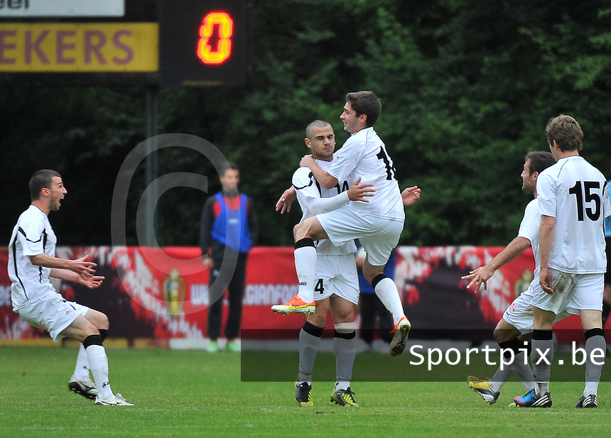 Georgia U19 - Belgium U19 : Luka Zarandia (18) jumps on the goalscorer Giorgi Pantsulaia (14) celebrating<br /> foto DAVID CATRY / Nikonpro.be