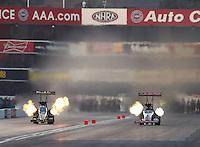 Nov 12, 2016; Pomona, CA, USA; NHRA top fuel driver Leah Pritchett (left) alongside Steve Torrence during qualifying for the Auto Club Finals at Auto Club Raceway at Pomona. Mandatory Credit: Mark J. Rebilas-USA TODAY Sports