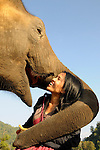 "Thailand's Elephant Nature Park owner Lek Chailert and 3-year old ""Hope"", whom she saved as an orphan and rehabilitated back to health 24/7 for many months."