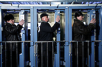 Chernobyl personnel check their contamination levels at the Semikhody radiation checkpoint where they enter and exit the Chernobyl Nuclear Power Plant. Every day, 3,800 workers commute by train into the Exclusion Zone to work at the Chernobyl plant. As long as nuclear fuel remains on site their jobs will continue -- so they have very little incentive to complete their work. <br /> ------------------- <br /> This photograph is part of Michael Forster Rothbart's After Chernobyl documentary photography project.<br /> &copy; Michael Forster Rothbart 2007-2010.<br /> www.afterchernobyl.com<br /> www.mfrphoto.com <br /> 607-267-4893 o 607-432-5984<br /> 5 Draper St, Oneonta, NY 13820<br /> 86 Three Mile Pond Rd, Vassalboro, ME 04989<br /> info@mfrphoto.com<br /> Photo by: Michael Forster Rothbart<br /> Date:  2/2009    File#:  Canon 5D digital camera frame 58058 <br /> ------------------- <br /> Original caption: .The Chernobyl Nuclear Power Plant (ChNPP or ChAES) is the site of the world's worst nuclear accident. On the night of April 26, 1986, the Fourth Block reactor exploded during a safety test, sending radioactive particles into the atmosphere and eventually around the world. The population within 30 kilometers was permanently evacuated, including residents of Pripyat and many villages...Although ChAES stopped generating electricity in December 2000, today 3,800 employees continue to work at the plant, commuting from the new city of Slavutych (population 24,300), which was built after the accident to replace Pripyat. Workers must pass through a radiation checkpoint each day before they board the train home..-------------------.