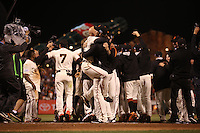 SAN FRANCISCO, CA - OCTOBER 16:  Tim Flannery and Madison Bumgarner celebrate at home plate after Travis Ishikawa of the San Francisco Giants hits a game-winning three run home run in the bottom of the 9th inning to defeat the St. Louis Cardinals 6-3 in Game 5 of the National League Championship Series to win the National League pennant and advance to the World Series at AT&T Park on Thursday, October 16, 2014 in San Francisco, California. Photo by Brad Mangin