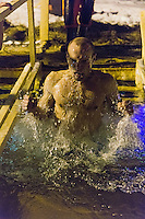 Moscow, Russia, 18/01/2016.<br /> A man emerges from the water as Orthodox Christian believers celebrate Epiphany at a lake in southern Moscow. Priests blessed the waters and followers baptised themselves by total immersion in the freezing lake in temperatures of minus 11C.